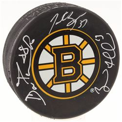 David Pastrnak, Brad Marchand  Patrice Bergeron Signed Boston Bruins Logo Hockey Puck (Pastrnak COA,