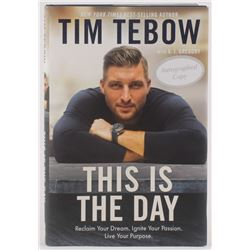 """Tim Tebow Signed """"This is the Day"""" Hard Cover Book (JSA COA)"""