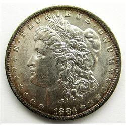 1884-O MORGAN DOLLAR BU RIM TONED