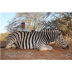 MOTSOMI SAFARIS 7-Day Hunt for 2 Hunters and 2 Non-Hunters for Impala, Wildebeest and Zebra in Main