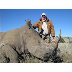 TAM SAFARIS 7-Day Trip for 1 Hunter and 1 Non-Hunter for the Chance to Dart a White Rhino in South A