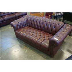 BURGUNDY LEATHER LOVESEAT BUTTON BACK AND BRASS STUDS
