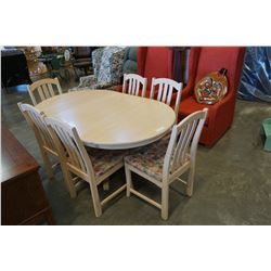 ROUND BLEACHED OAK TABLE W/ 2 LEAFS AND 6 CHAIRS