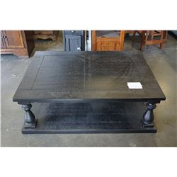 ASHLEY FLOOR MODEL RUSTIC BLACK FINISH 40X55 INCH COFFEE TABLE, RETAIL $1199