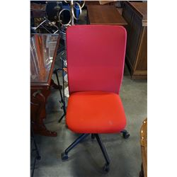 RED UPHOLSTERED OFFICE CHAIR