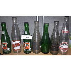7 VINTAGE GLASS POP BOTTLES
