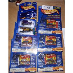 7 HOT WHEELS IN UNOPENED PACKAGES