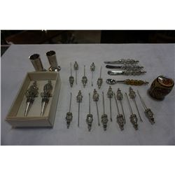 LOT OF METAL AND GLASS BUTTER KNIVES, WINE STOPPERS, SKEWERS