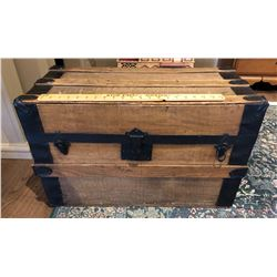 ANTIQUE WOOD TRUNK WITH WROUGHT IRON DETAILING