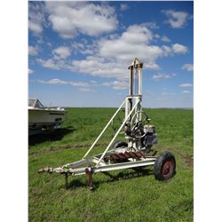 """Long-Airdox Co. post hole drill, pull-behind, gas engine, 8"""" bit"""