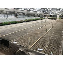 APPROX. 60' X 5.5' METAL GRATED GREENHOUSE SLIDING BENCH, COMES WITH ATTACHED IRRIGATION AND PIPING