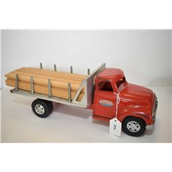 Vintage pressed tin Tonka stake bed truck with galvanized checked aluminium deck and working roller