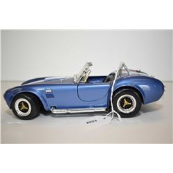 Die cast 1965 Ford Cobra with working doors, trunk, and hood, 8 1/2  in length, 1:18 scale