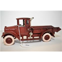 """Vintage/antique cast iron dump truck with crank up box, working and rubber tires, 10 1/2"""" in length,"""
