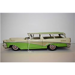 Vintage pressed tin 1959 Fairlane Ranch Wagon friction car with drop down tail gate, made in Japan,