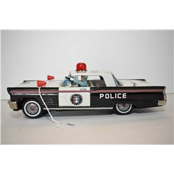 Japanese made pressed tin battery operated police car with shooting driver, in excellent all origina
