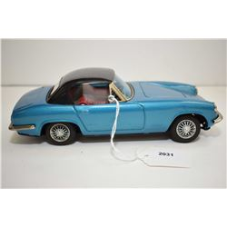 """Pressed tin Lotus Elan friction car with right hand steer, 8 1/2"""" in length and made in Japan"""