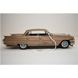 """Pressed tin Cadillac friction car, made in Japan 8"""" in length"""