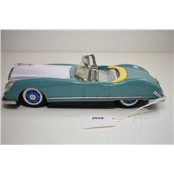 Pressed tin friction driven convertible car with lifting hood and operating engine fan, made in Chin
