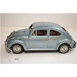 Pressed tin, battery operated Volkswagen Beetle made in Japan with clear engine compartment and ligh