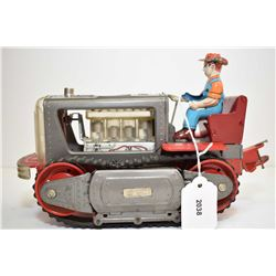 Pressed tin, battery operated, lighted piston action tractor, made in Japan, 10  in length