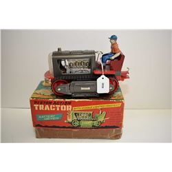 Pressed tin, battery operated, lighted piston action tractor, made in Japan, in mint condition with