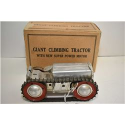 """Louis Marx Giant Climbing Tractor, wind-up action, note missing on track, 8"""" in length"""