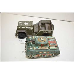 """Two pressed tin friction driven toys including tank and a 7"""" long jeep, both made in Japan"""