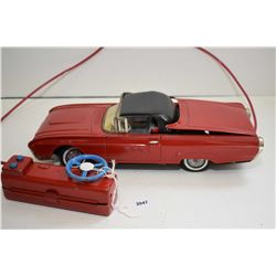 Ford Thunderbird pressed tin, battery operated car with retractable roof, needs some minor wiring re