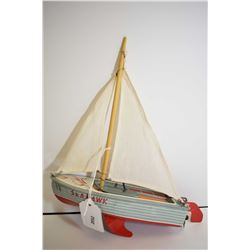 """Haji made in Japan Seahawk wind-up pressed tin sail boat with cotton sails, 8 1/2"""" in length"""