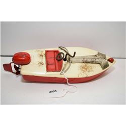 """Pressed tin, wind-up motorboat, 9"""" in length"""