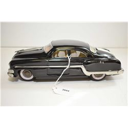 """Pressed tin, friction driven Buick/Oldsmobile car, 10"""" in length"""