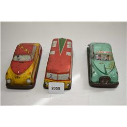 Three pressed tin English made cars including a taxi, an Army staff car and a bus, all approximately