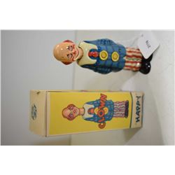 German made Distler Happy Clown wind-up tin toy with original box and key