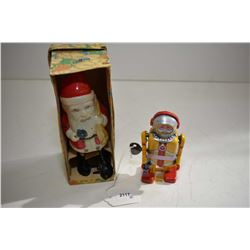 Two vintage wind-up toys including Santa Claus made in Occupied Japan with original box and a robot