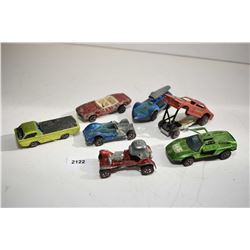 Selection of seven Redline Hotwheels cars including dragster funny car, Firebird, Red Baron car, Deo