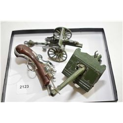 Two die cast metal cannons, one made by Britains and one made by Crescent, both with working firing