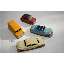 Selection of four Dinky Toys including Ford Sedan No. 170, Bedford Kodak Camera van, Mini Minor and