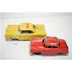 "Two Japanese made pressed tin friction cars including a yellow cab 6"" in length and an Airport Limou"