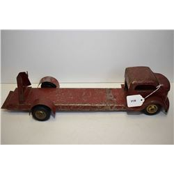 Vintage pressed tin toy fire truck made by Lincoln, missing front wheel and ladders