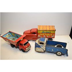 Selection of three vintage pressed tin toys trucks including Banner Toy Truck No.781, Japanese made