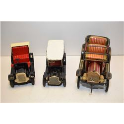 "Three pressed tin friction driven toys including 1920's cars and cab 6"" in length"