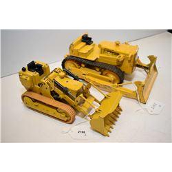 Two die cast construction equipment trucks including German made Caterpillar/loader and an Internati