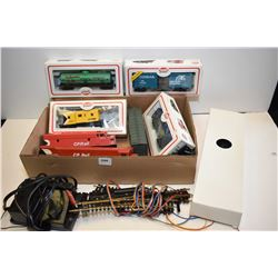 Selection of HO scale train accessories including electric engines, rolling stock, track and control
