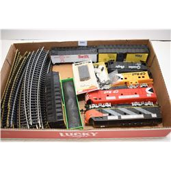 Selection of HO scale train accessories including electric engines, rolling stock and track