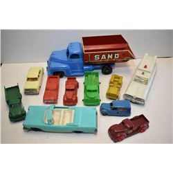 Selection of vintage plastic toys including cars, trucks, military vehicles, ambulance etc.