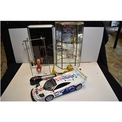 Selection of collectibles including celluloid trapeze figure, remote control car sans remote, toy sc