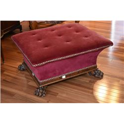 Antique button tufted foot stool with hinged lid for storage and fitted with large carved paw feet