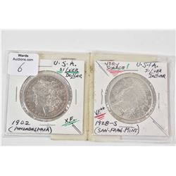 Two American silver dollars including 1902 from the Philadelphia mint and a scarce 1928 -S from the