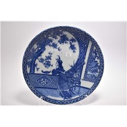 "Antique Oriental blue and white charger with woman overlooking her garden scene, 14 1/2"" in diameter"